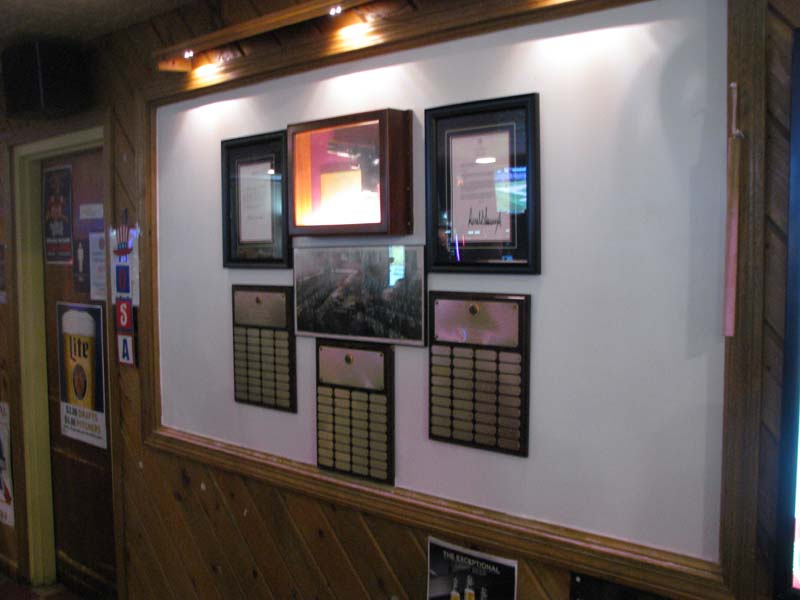 Plaque Display (starting form the left top row) President Clinton Citation, Pistol and President Trump Citation