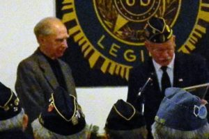 CMDR Hunt presents award for 60 years continuous membership to Jack Meisel.