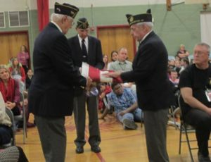 Honor Guard sharing proper folding of the American Flag w a large captive audience at Southside Middle School. Presentation by Jack Meisel, James Connelly, and Seargent at Arms Grosenbeck.