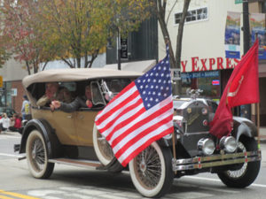 Grand Marshall Lionel LeBlanc travels in style down Elm St in the Veterans Day Parade