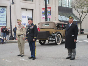 Grand Marshall Lionel LeBlanc, CDR Manchester Veteran's Council & 2nd Vice Beliveau, Judge Advocate Lopez salutations in front of City Hall.